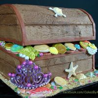 "Treasure Chest Lid is 8"" rounds cut in half and the bottom is 11x18 sheet pan cut in half and stacked. So fun! All hand made white chocolate shells,..."