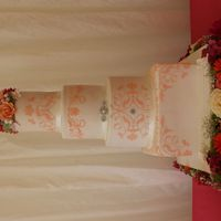 Coral Wedding Cake Coral, pink and orange theme with stencilled design