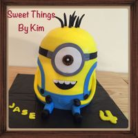 Minion 3 six inch vanilla with half ball pan cake top frosted in BC with gumpaste/fondant decorations. (pants, hair arms legs eye)