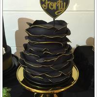 Gold And Black Birthday Cake  The fourth cake at our wedding was my 40th birthday cake. The large black ruffles were edged with gold and the stand set it off beautifully...