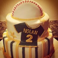 Baseball Themed Baby Shower Cake  One of my very first tiered cakes. It was baseball themed for the welcoming of a son to my friends family The cake was buttercream with...