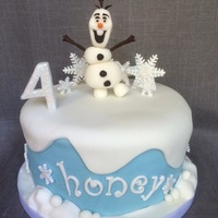 Olaf Cake 8 inch chocolate cake filled and covered with chocolate buttercream.