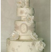 Classic Wedding Cake Wedding cake with laces and roses made of wafer paper.