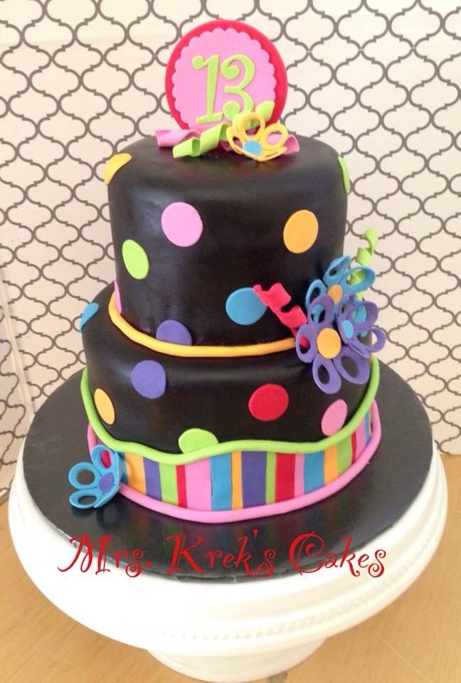 Neon Birthday Cake is covered in fondant with fondant decor.