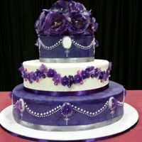 "Purple Wedding Cake Purple wedding cake, 8"", 12, 16"". White cakes with raspberry filling in top and bottom tiers. Lemon filling in the second tier...."