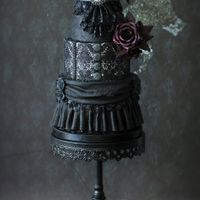Black Gothic Wedding Cake Today I finished this small gothic wedding cake that serves about 20 - 22 people. It is completely edible, although I wouldn't eat the...