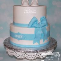 "Baby Booties & Bow 8"" & 10"" caked iced in buttercream w/fondant decorations. TFL!"