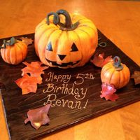 Pumpkin In Fondant This cake turned out so cool! Even the board was awesome!! My friends thought it was a center piece! The only thing I forgot to do was vein...