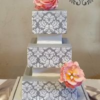 Gray Damask Wedding Cake 6, 8, and 10 inch square dummies covered in gray fondant and stenciled with royal icing for a bridal show. Pink open peonies to add a...