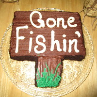 Gone Fishin' This is a cake I whipped together this morning. It's a WVSC cake with chocolate buttercream frosting. The sides are coated with oreo...