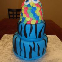 Zebra-Print Owl Cake A Zebra-print cake with a very colourful owl topper