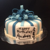 Blue Stripes Fondant Cake This is a simple blue stripe with ribbon fondant cake hope you like