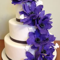 Purple Anemone Wedding Cake Wedding cake with charcoal and purple cascading anemones (gumpaste)