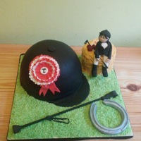 Horse Riding Novelty Cake The hat is a Madeira sponge covered with white chocolate ganache and filled with raspberry conserve and vanilla cream. The hay bale is made...
