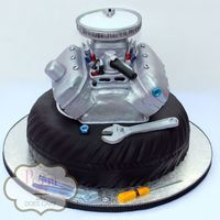 "Engine Cake Bride sent me a photo of the groom's engine he was rebuilding and I ""tried"" to make it into a cake!"