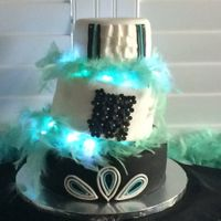 Topsy Turvy With Lights Created for a friends 70th Birthday. Three layers tiered and added battery operated lights.