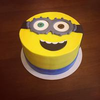 Bob The Minion Cake Minion cake for a 10th birthday. The flavor was red velvet and cream cheese and it is iced in a crusting cream cheese.
