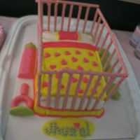 Crib Cake  Simple crib cake I made for my friend's baby shower. So simple and cheap but delicious. Pineapple flavor with buttercream frosting,...