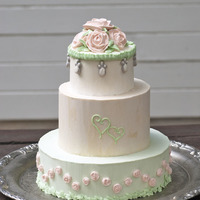 Vintage Wedding Cake Buttercream wedding cake with royal icing roses, jewels and hearts.