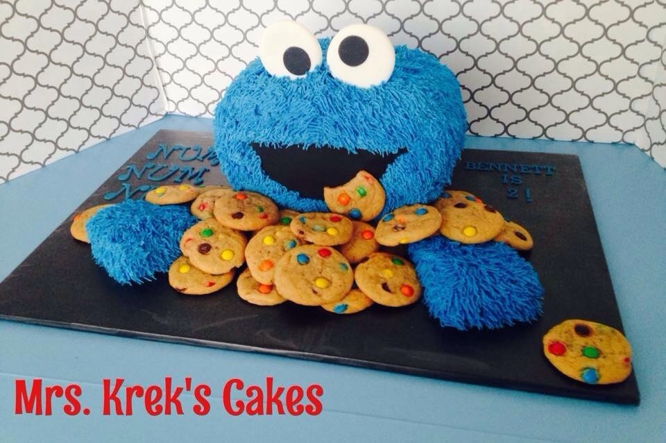 Cookie Monster Cake Iced in buttercream ( fur tip), fondant facial features. Cookies are home made.