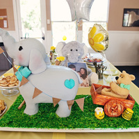 Baby Shower Elephant Cake elephant is strawberry and vanilla with buttercream and white chocolate ganache. legs are rice Krispies and chocolate. The bear its all...