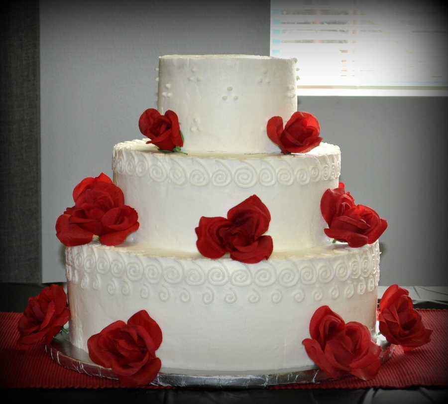 White Wedding Cake With Silk Roses