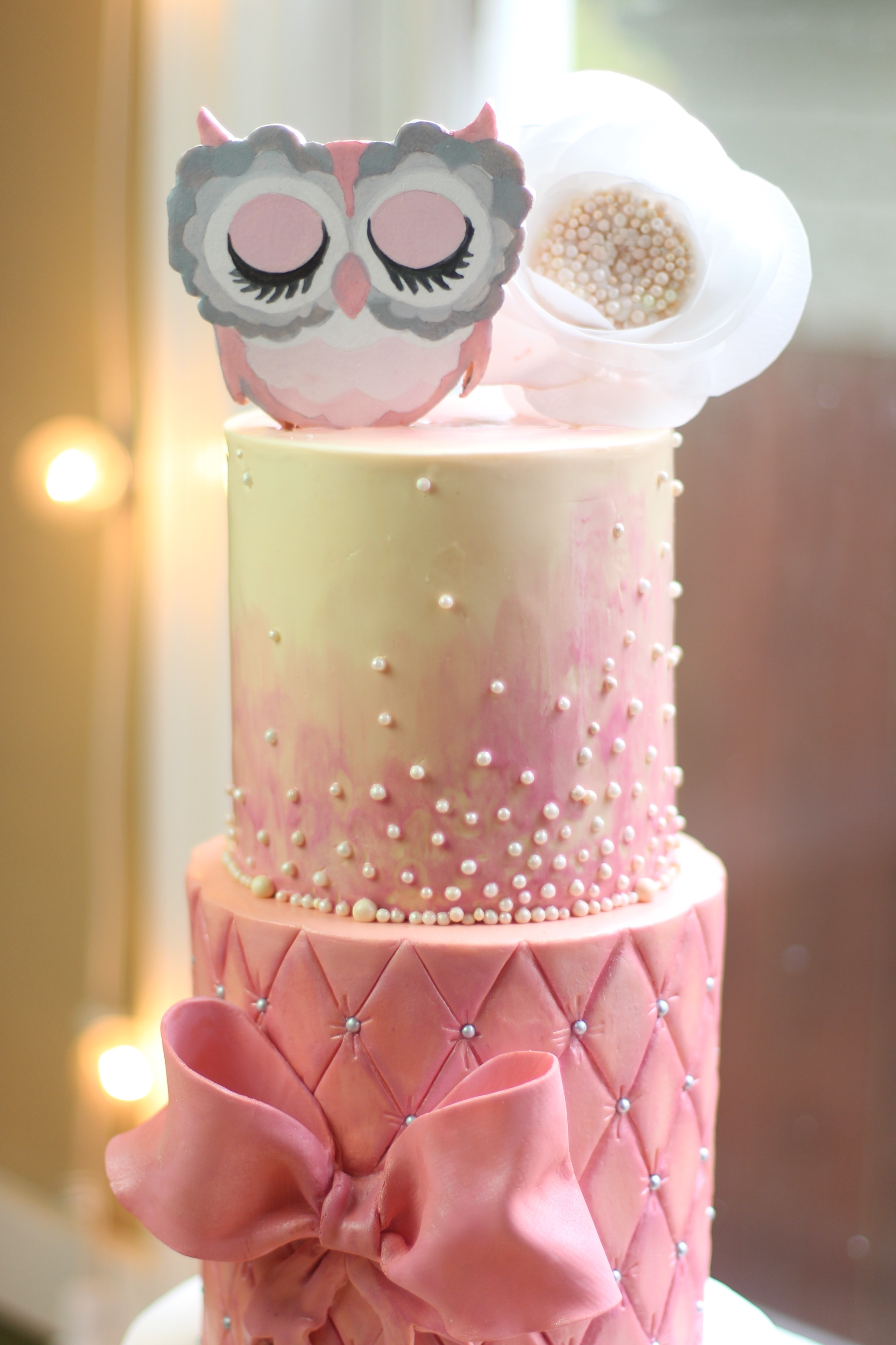 Pretty In Pink Baby Shower Cake. Red Velvet With Cream Cheese Buttercream.  8 In, 6in And 5 In Tiers. Hand Painted Owl Topper With Wafer Paper Flower.