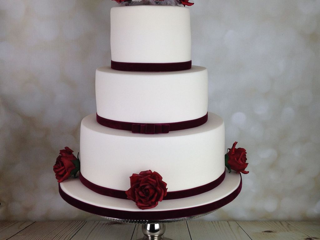 Red Roses And White Feathers Wedding Cake - CakeCentral.com