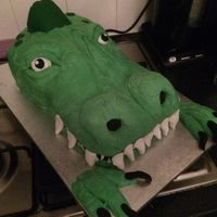 Dinosaur Cake I made this, for a friend... wanted a dinosaur, ended up with a croc! hahaha never mind loved it anyway!