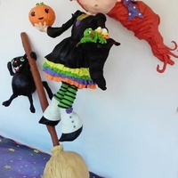 "Wendy The Witch On A Broom 36"" tall, gravity defying and balancing witch on her broom, as she flies frantically swooshing through the air. Hanging cat is hanging..."