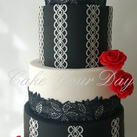 Black And White Wedding Cake Black&White Wedding cake with edible lace, wafer paper lace and sugar roses.