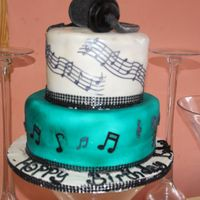 Musical Notes   Pound cake covered with lemon favor fondant. Laced icing musical notes on top cake.