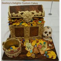 Treasure And Jewels This was my entry to the 2015 Great American Cake Show. The treasure chest was covered in fondant and made to look like aged wood. With...