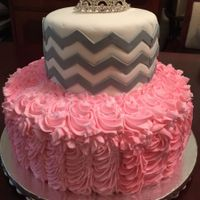 Pink And Grey two tier cake with buttercream on bottom tier and fondant with chevron on top tier.