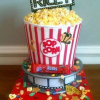 Movie-Themed Cake Movie-themed popcorn cake. Fondant candy & edible images. No real candy used on the cake.