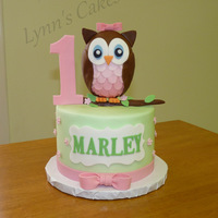 Owl 1St Birthday Cake This sweet little cake was vanilla cake iced in buttercream with fondant owl topper and fondant accents.