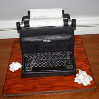 Vintage Typewriter Cake Royal typewriter cake. Chocolate WASC cake, hazelnut SMBC icing, fondant details, edible image for the typewritten page.