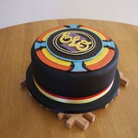 Elo Spaceship   Rich chocolate cake, filled with chocolate buttercream, decorated with fondant.
