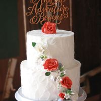 Rustic Burnt Orange Roses Cak This is a rustic iced wedding cake with burnt orange and white roses. The setting was in barn with horses and all
