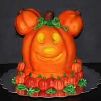 Mickey Mouse Jack-O-Lantern Sculpted cake using cake, fondant and rkt.