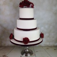 Red Roses And White Feathers Wedding Cake  A huge Congratulations to a lovely couple, Gary and Claire who celebrated their marriage yesterday. I absolutely love Deep red roses ! My...