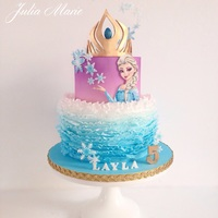 Frozen Birthday Cake A two tiered birthday cake, with ombré ruffles on the bottom tier and an airbrushed ombré effect on the top tier,...