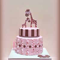 Cute Giraffe Birthday Cake Chic and elegant two tier giraffe themed birthday cake with various decorative details such as fondant ruffles and stripes in pink and...