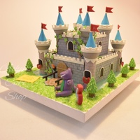 Château De Boy Castle Cake for a four year old boy; with Barnie character.Most of the things are done with Fondant, there is running water effect made...
