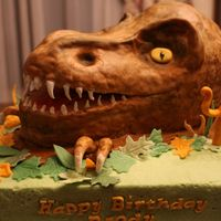 T Rex Dinosaur Cake   Made with 2 layers 7 inch oval with rice krispie treats on top and sides.
