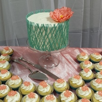 Turquoise And Coral Wedding Cake and Cupcakes for my sister's wedding. Cake is vanilla with buttercream frosting and flower is gumpaste.