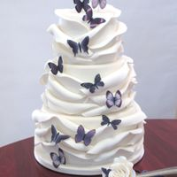 Butterfly Wrap Wedding Cake My rose wrap cake with purple butterflies and knife spray. Hummingbird Cake with cream cheese ganache (salted white chocolate & Lorann...