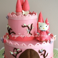 Hello Kitty Castle Two level 1st birthday cake. the Kitty figure is handmade. Lovely castle isn't it? ;-)