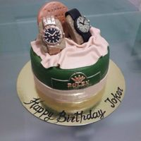 Rolex Watch Cake was really fun doing this cake although i was so worried the watches would fall of the cake or somethingthankfully they were very stable...