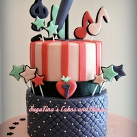 'pop And Rock' Cake two level chocolate cake filled with cookie buttercream and vanilla flavor cream.